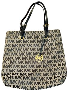 80c1df5d60ac Michael Kors Canvas Large Tote in Black leather handles Gold Hardware and  black and sand body
