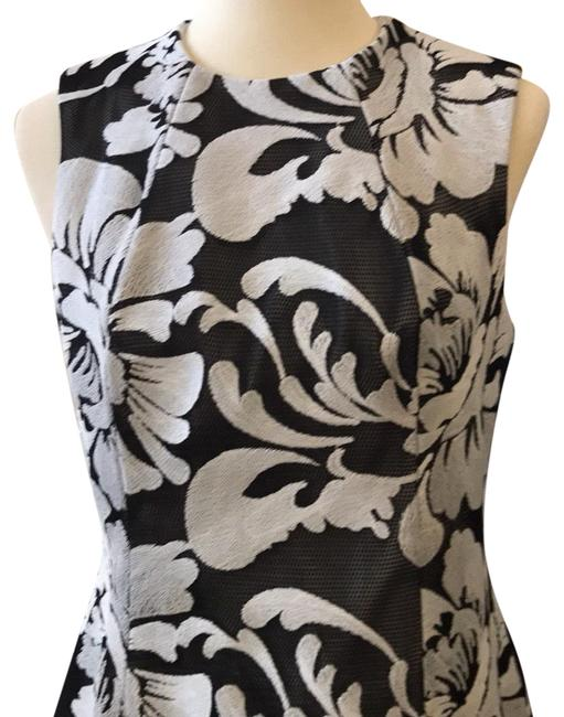Preload https://img-static.tradesy.com/item/23948956/black-with-white-flowers-mid-length-night-out-dress-size-12-l-0-3-650-650.jpg