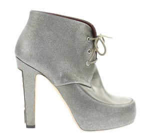 fe460810fa3f Silver Chanel Boots   Booties - Up to 90% off at Tradesy