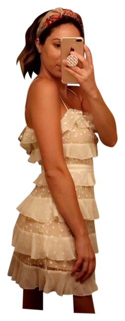 Preload https://item1.tradesy.com/images/forever-21-white-and-ivory-ruffled-a-line-cocktail-dress-size-8-m-23964430-0-1.jpg?width=400&height=650