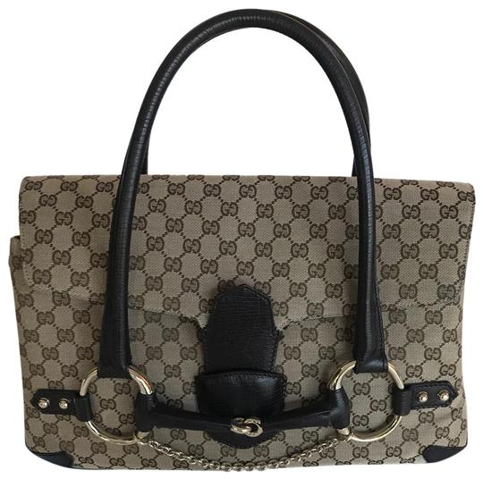 Preload https://item3.tradesy.com/images/gucci-horsebit-tom-ford-era-print-brown-canvas-shoulder-bag-23964442-0-1.jpg?width=440&height=440