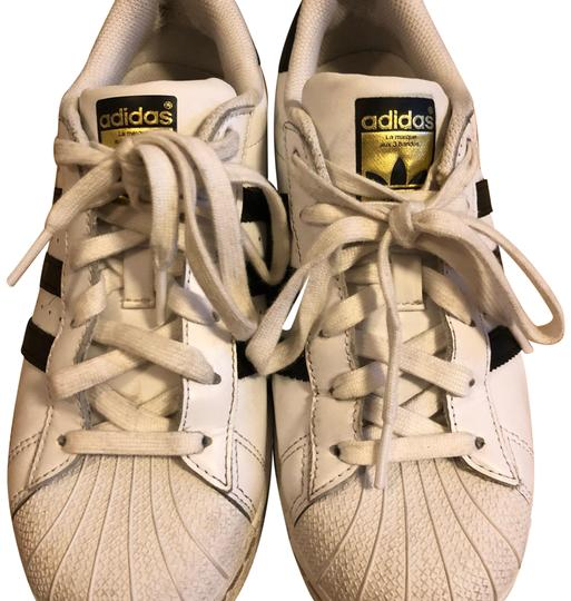 Preload https://item5.tradesy.com/images/adidas-white-with-black-superstar-sneakers-size-us-65-regular-m-b-23964729-0-1.jpg?width=440&height=440