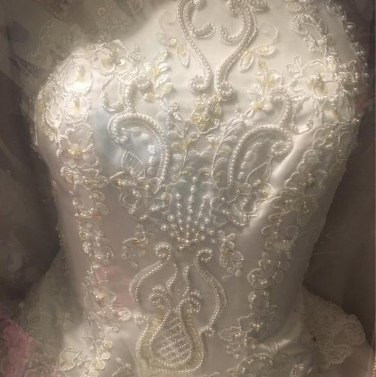 Preload https://item5.tradesy.com/images/white-traditional-wedding-dress-size-6-s-23964949-0-0.jpg?width=440&height=440