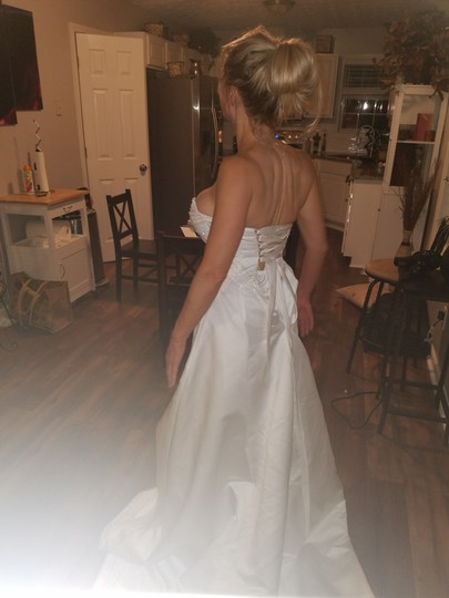 Preload https://item1.tradesy.com/images/maggie-sottero-white-tag-it-s-on-traditional-wedding-dress-size-4-s-23965095-0-0.jpg?width=440&height=440