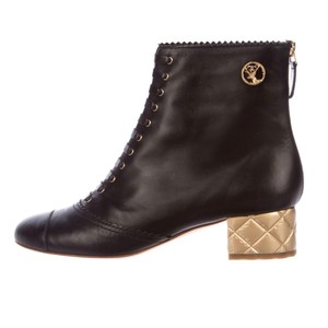 Chanel Black with gold Boots
