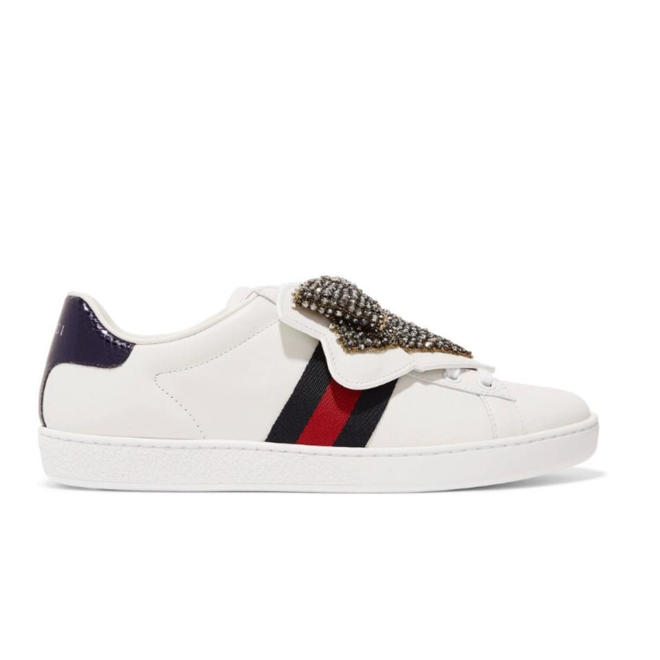 f881dd8ecd00 Gucci Ace Crystal Bow Embellished Water Snake Trimmed Leather ...