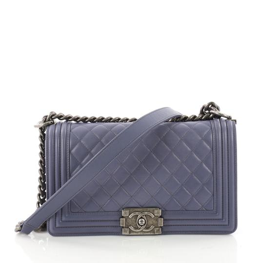 Preload https://item3.tradesy.com/images/chanel-classic-flap-boy-quilted-old-medium-blue-lambskin-leather-shoulder-bag-23973342-0-0.jpg?width=440&height=440