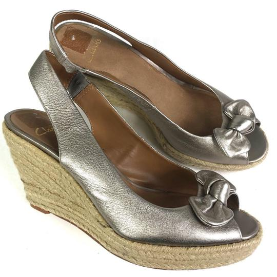 Preload https://item1.tradesy.com/images/clarks-metallic-women-s-bow-detail-espadrilles-wedges-size-us-5-regular-m-b-23973635-0-0.jpg?width=440&height=440