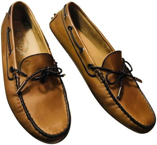 Preload https://item4.tradesy.com/images/tod-s-black-brown-leather-loafers-moccasins-driving-flats-size-eu-405-approx-us-105-regular-m-b-23973848-0-1.jpg?width=440&height=440