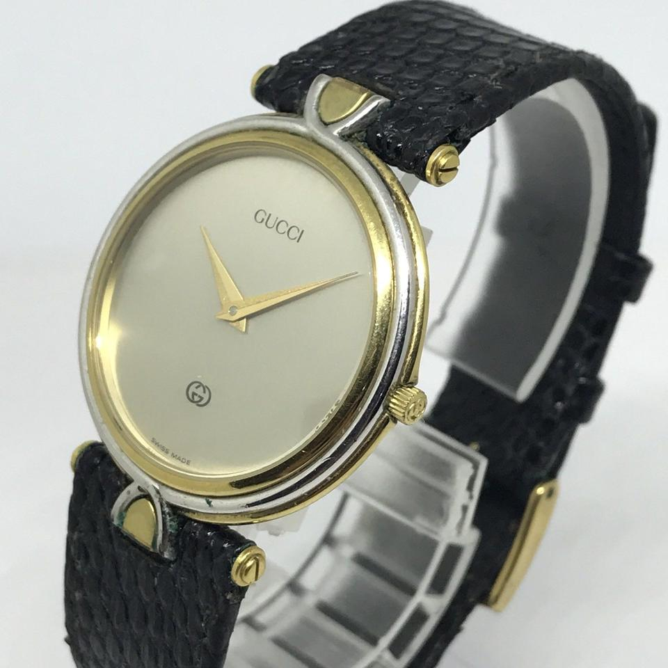 8de0e138989 Gucci Gold   Black Vintage 4500m 18k Plated Steel Two Tone Unisex Quartz  Watch - Tradesy