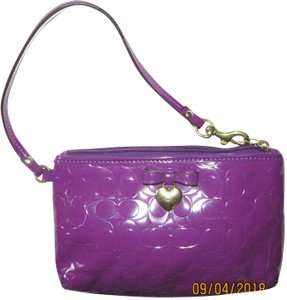 Coach Patent Leather Wristlet in purple