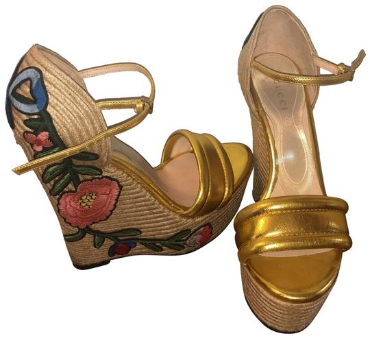 Preload https://img-static.tradesy.com/item/23979776/gucci-gold-with-flower-and-now-applique-wedges-size-eu-37-approx-us-7-regular-m-b-0-1-540-540.jpg