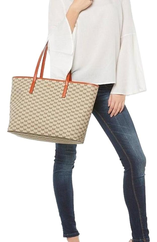 a489eba93aab Michael Kors Emry Large Top Zip Heritage Signature Natural / Orange Coated  Canvas Tote