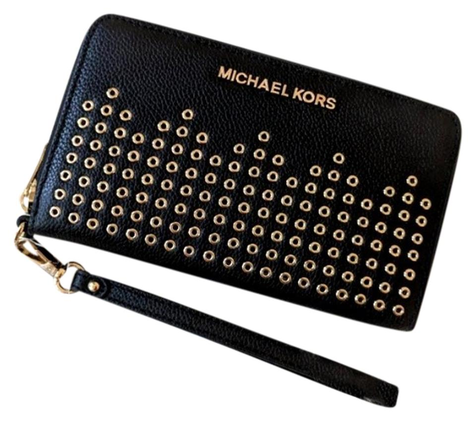 5e731e45260a Michael Kors Michael Kors Hayes Large Jet set travel phone case grommeted  wristlet Image 0 ...