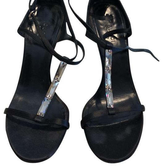 Preload https://item3.tradesy.com/images/gucci-black-with-mirrored-design-sandals-size-us-75-regular-m-b-23997242-0-1.jpg?width=440&height=440