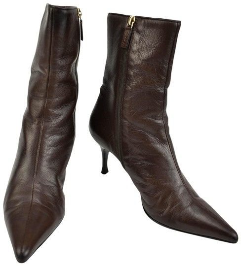 Preload https://img-static.tradesy.com/item/23997410/gucci-dark-brown-leather-and-logo-short-bootsbooties-size-us-6-regular-m-b-0-1-540-540.jpg