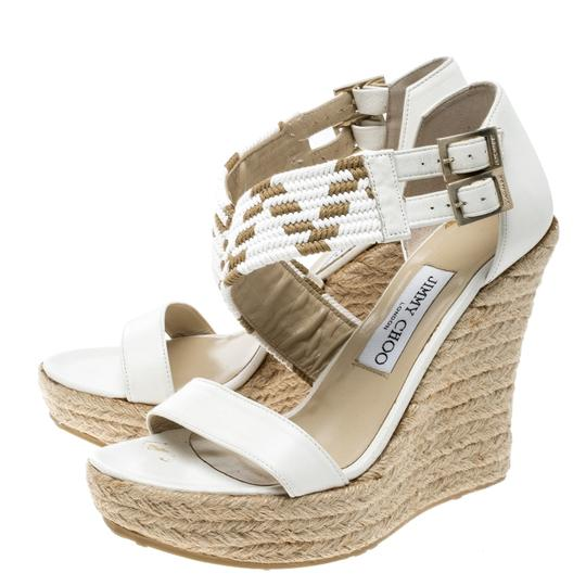 Preload https://item4.tradesy.com/images/jimmy-choo-white-leather-woven-cross-strap-espadrille-wedge-sandals-size-eu-38-approx-us-8-regular-m-23997423-0-0.jpg?width=440&height=440