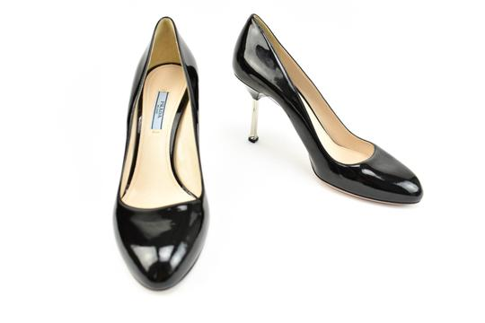 Preload https://item3.tradesy.com/images/prada-black-patent-leather-and-silver-stiletto-heels-pumps-size-eu-40-approx-us-10-regular-m-b-23997497-0-0.jpg?width=440&height=440