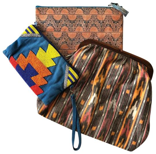 Preload https://img-static.tradesy.com/item/23997695/ikat-tribal-foldover-multicolor-cotton-blend-clutch-0-1-540-540.jpg