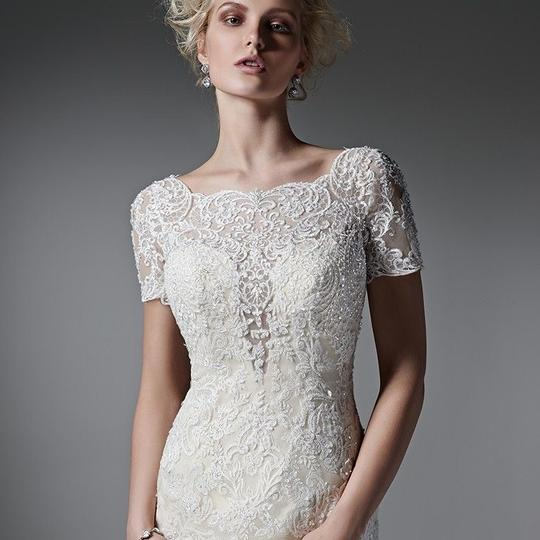 Preload https://item5.tradesy.com/images/maggie-sottero-ivorychampagne-lace-tuerney-modest-wedding-dress-size-12-l-23997714-0-0.jpg?width=440&height=440