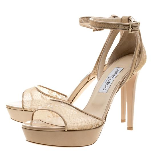 Preload https://item4.tradesy.com/images/jimmy-choo-beige-lace-and-patent-leather-kayden-ankle-strap-platform-sandals-size-eu-405-approx-us-1-23997733-0-0.jpg?width=440&height=440