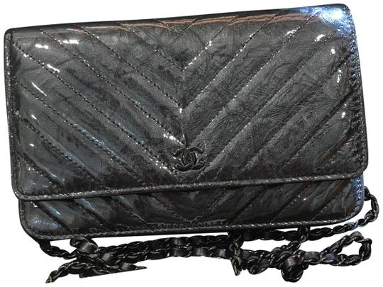 Preload https://img-static.tradesy.com/item/23999178/chanel-wallet-on-chain-new-woc-so-crumpled-calf-patent-18s-black-leather-cross-body-bag-0-1-540-540.jpg