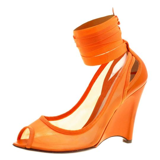 Preload https://img-static.tradesy.com/item/23999359/fendi-orange-mesh-and-leather-ankle-wrap-cut-out-wedge-pumps-size-eu-37-approx-us-7-regular-m-b-0-0-540-540.jpg