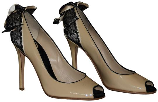 Preload https://img-static.tradesy.com/item/23999562/dolce-and-gabbana-nude-dolce-and-gabbana-patent-leather-peep-toe-couture-lace-bow-pumps-size-us-85-r-0-1-540-540.jpg