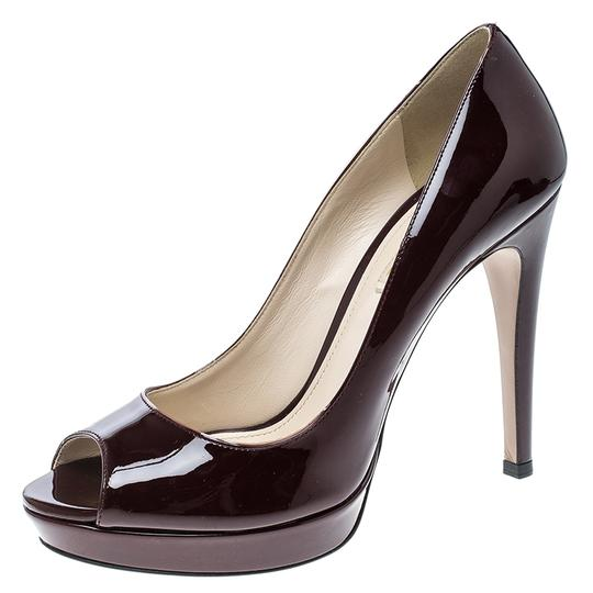 Preload https://img-static.tradesy.com/item/24000016/prada-burgundy-patent-leather-peep-toe-platform-pumps-size-eu-39-approx-us-9-regular-m-b-0-0-540-540.jpg