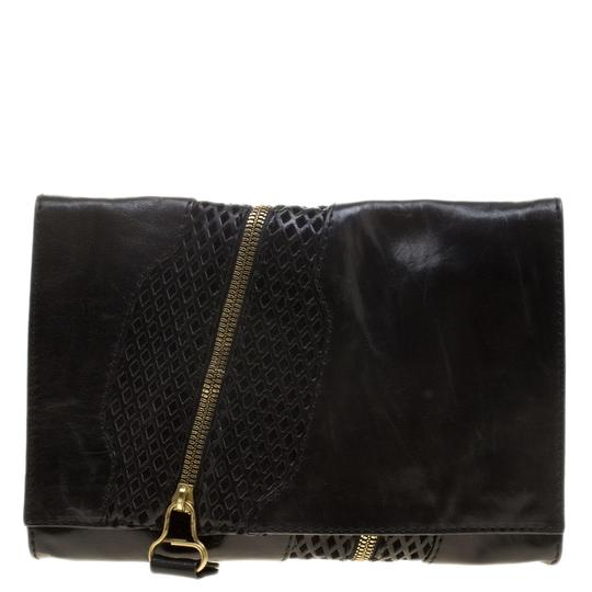 Preload https://img-static.tradesy.com/item/24000133/jimmy-choo-perforated-martha-black-leather-and-suede-clutch-0-0-540-540.jpg