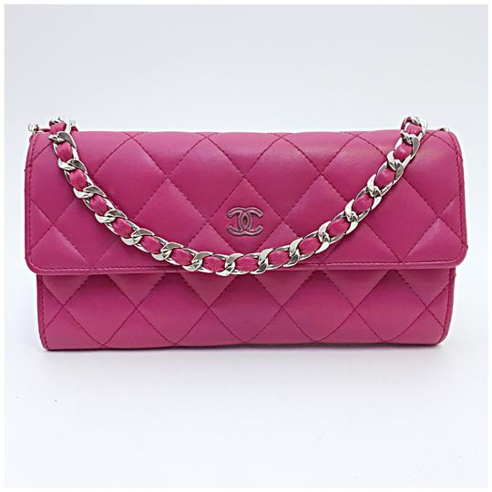 Preload https://img-static.tradesy.com/item/24000174/chanel-classic-flap-wallet-with-chain-added-pink-lambskin-leather-clutch-0-0-540-540.jpg