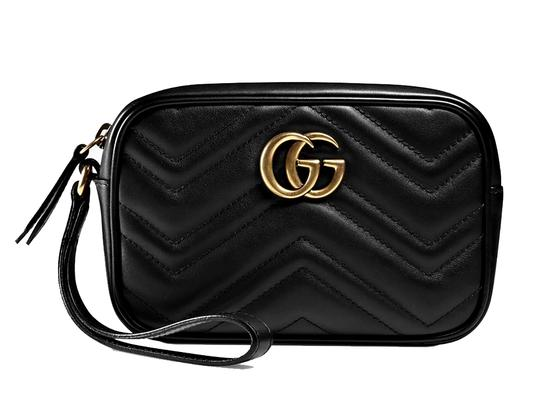 Preload https://item3.tradesy.com/images/gucci-marmont-gg-20-medium-quilted-wristlet-black-leather-clutch-24009632-0-0.jpg?width=440&height=440