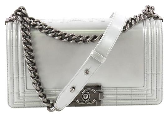 Preload https://item5.tradesy.com/images/chanel-classic-flap-boy-reverso-glazed-iridescent-calfskin-old-medium-silver-leather-shoulder-bag-24009669-0-1.jpg?width=440&height=440