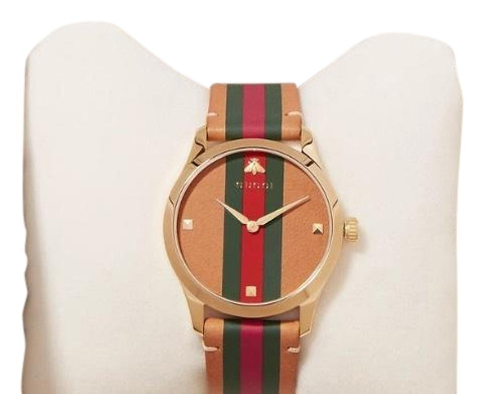 95c76a27d4 Gucci Tan Green and Red Leather G-timeless Striped Gold Tone Watch ...