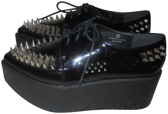 Preload https://img-static.tradesy.com/item/24015517/city-snappers-black-with-spikes-platforms-size-us-85-regular-m-b-0-2-540-540.jpg