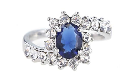 Preload https://img-static.tradesy.com/item/24015940/white-250-ctw-blue-sapphire-halo-simulated-crystal-rhodium-plated-ring-0-0-540-540.jpg