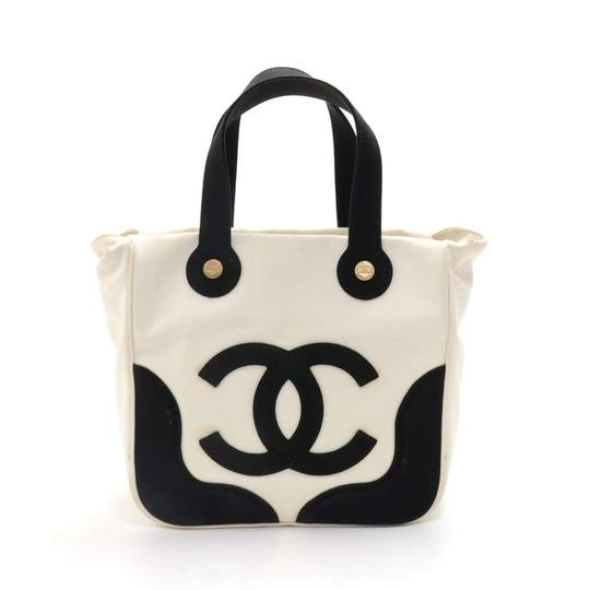 Preload https://img-static.tradesy.com/item/24016043/chanel-marshmallow-black-and-limited-edition-white-canvas-tote-0-0-540-540.jpg