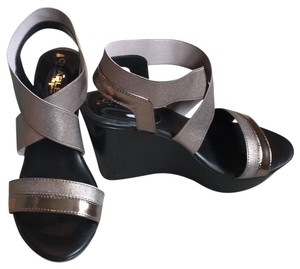 Charles by Charles David Pewter, with a taupe gold undertone. Platforms