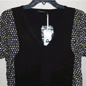 52aabf7e17 Kookaï Black Sheer Halter Top.  19.99. US 2 (XS). Kookaï Top Black  multi-color