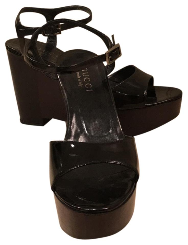 73aa020d0b9 Gucci Black Patent Leather Heels and Straps with Glossy Brownish Black  Wooden Wedges Platform Sandals