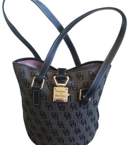 Dooney & Bourke Tote in Black canvas monogram with light black background and black leather trim. Cute silver buckle and key closure with the DB logo