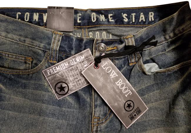 Item - Blue Distressed Low Boot Cut Jeans Size 30 (6, M)
