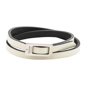 Gucci Sterling silver Gucci leather wrap bracelet featuring designer engraving and buckle closure. Designer size 20.
