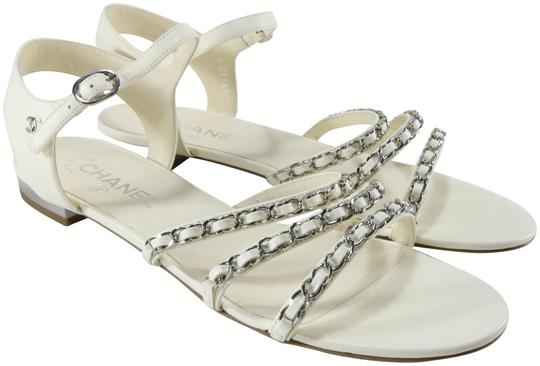 Preload https://img-static.tradesy.com/item/24033332/chanel-ivory-white-silver-18p-lambskin-chain-straps-strappy-classic-b115-sandals-size-eu-41-approx-u-0-1-540-540.jpg