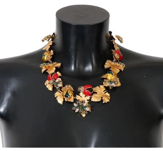 Preload https://img-static.tradesy.com/item/24034723/dolce-and-gabbana-multicolor-dy1116-women-s-gold-brass-floral-crystal-ladybug-statement-necklace-0-1-540-540.jpg