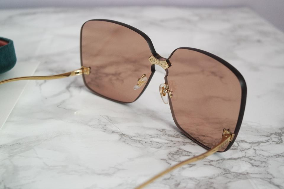 49d454b337d Gucci Brown New Gg0352 S Oversized Rimless Curved Leg Sunglasses ...