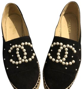 Chanel Black with white/beige pearls. Flats