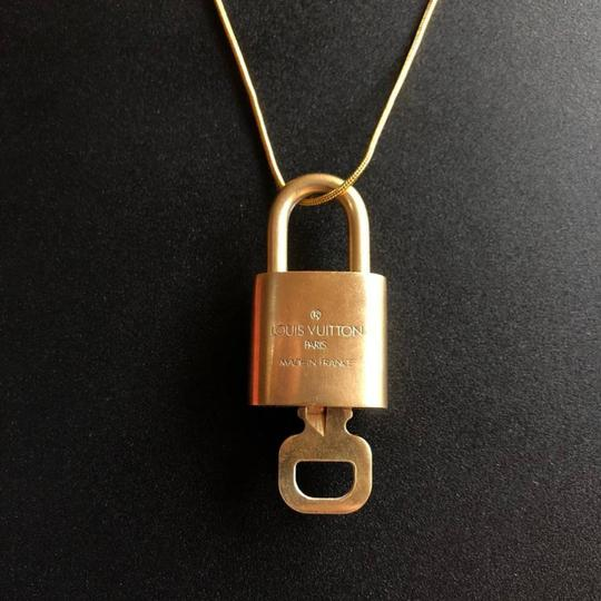 Louis Vuitton Gold Single Key Lock Pad Lock and Key 867780 Image 11