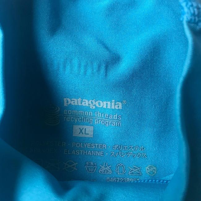Preload https://img-static.tradesy.com/item/24042932/patagonia-teal-women-s-common-threads-blouse-activewear-top-size-16-xl-plus-0x-0-1-650-650.jpg