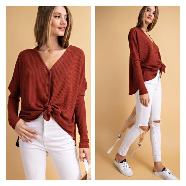 Preload https://img-static.tradesy.com/item/24044519/rust-red-cardiganpullover-button-down-top-size-6-s-0-0-650-650.jpg